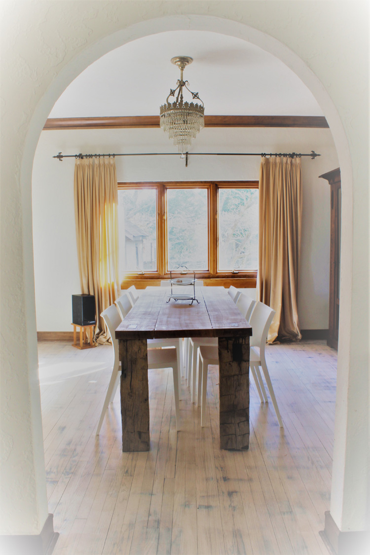 21st Century Gothic room. A view of room and table through arch.